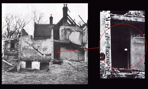 A photo capturing a brick rising from the rubble in the doorway
