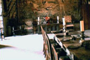 A ghostly presence is captured on film sat in the chair on the left at the back of the hall